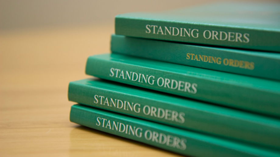 A pile of editions of the Standing Orders.