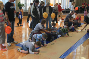 Children creating a mural at Open Day.