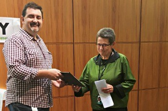 David Wilson, incoming Clerk of the House of Representatives, presents Mary Harris with a special Hansard transcript.