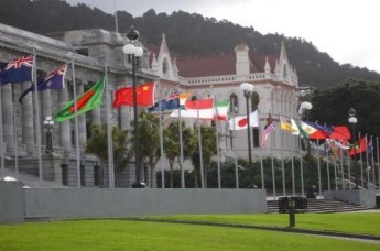 Flags flying in front of Parliament House